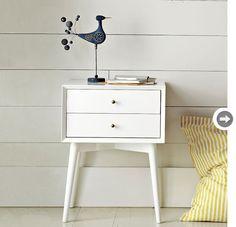 mid-century modern decor: sleek nightstand.
