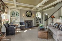 Not a fan of the furniture or décor of this space, but the structural details are beautiful.  Love the windows, door frame, ceiling and staircase!