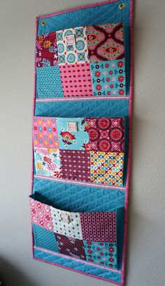 this wall organizer New, WIP, Phew. As in, new projects, works in progress and completed (phew!) projects.