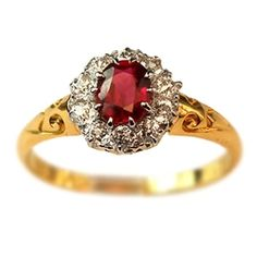 Rare authentic ruby and diamond Victorian wedding ring crafted with 18k yellow gold - circa 1890s - at Turtle Love for $1,420. The design of this ring with sinuous curves on the band and a ring of diamonds around a brilliant gemstone is a hallmark of the bright yet artistic styles of the late Victorian period...which inspired the elegant filigree Edwardian styles of the early 1900s.