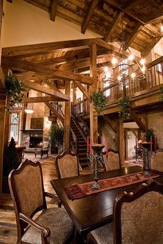 Exposed Southern Yellow Pine timber framing and a gorgeous dining area!