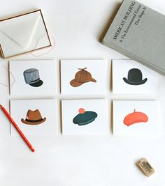 Assorted hat card set at Newspaper Taxi