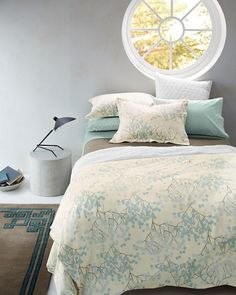 Flannel sheets with a subtle blue print pair with solid flannel bedding for a cozy and serene master bedroom.
