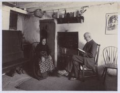 Photograph entitled 'The Old Folks at Home, an old couple seated on either side of fire place in country kitchin', 1898. The National Archives catalogue reference: COPY 1/438/173