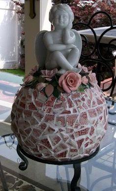 garden junk, pink roses, balls, rose mosaic, garden statues, angels, broken china, mosaic designs, bowling ball