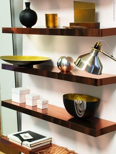 Create a metallic stylish shelves with this easy IKEA DIY project. Cooper contact paper plus LACK shelves equals a beautiful way to display in your living room.