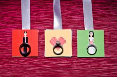 An image of the wedding rings, incorporating the couple's video game wedding theme.