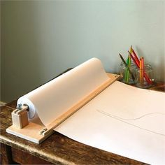 this tabletop paper cutter would be handy in an office