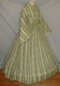 "Enchanting 1860's Green Leaf Print Cotton Dress | eBay seller fiddybee, pagoda sleeves, neck, armscyes, waist are piped, front brass hook & eye closure, bodice lined in cotton, unlined skirt attached w/ cartridge pleating; 3"" period mend on lower skirt edge, new hooks & eyes added but original are present; bust: 34""; waist: 26""; skirt length: 41""; hem width: 146"" summer dresses, print cotton, enchant 1860s, 1860s green, civil war, cotton dress, ebay, brass, sleeves"