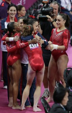 Team USA  U.S. gymnasts celebrate after their routine on the vault during the Artistic Gymnastic women's team final at the 2012 Summer Olympics, Tuesday, July 31, 2012, in London. (AP Photo/Gregory Bull)