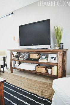 Layered rugs//tv console//glidden wood smoke flat wall paint