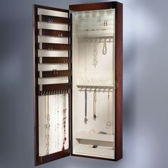 The 45 Inch Wall Mounted Lighted Jewelry Armoire inside of a mirror- Hammacher Schlemmer, where form meets function. Great for the walk in closet!