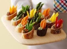 Veggie Dip in Baguette Rounds...I am making this tomorrow for an outside get together; clever idea as in no utensils needed and no mess! Perfect finger food.
