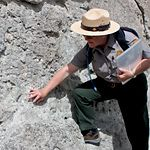 A ranger points out a fossil on the Fossil Discovery Trail - Dinosaur National Monument