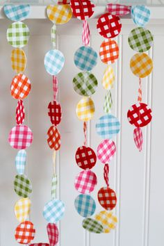 Rainbow Gingham Fabric Garland 6 feet, Red, Orange, Yellow, Green, Blue, Pink. $12.00, via Etsy.
