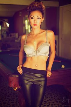 Hot slim Asian girl wearing the black leather pants