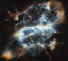 """A grinning one-eyed skull? Actually it's NGC 5189, a complex planetary nebula around a dying star. (Credit: NASA/JPL-Caltech/S.Carey (Caltech)) Mona Evans, """"Cosmic Halloween Tour"""" http://www.bellaonline.com/articles/art52161.asp"""