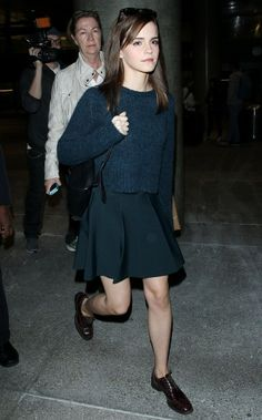 Emma Watson in chunky navy sweater, flared skirt, and oxfords