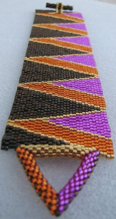 Opposing Triangles Peyote Cuff - by Sand Fibers with matching beaded triangle toggle clasp