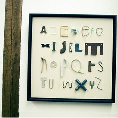 """Found Alphabet"" framed in shadow box. A fun summer activity for kids to search for the alphabet in found objects."