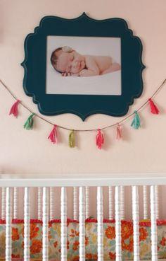 frame, tassel garland, crib, dresser, mint baby banner