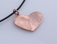 Personalized thumbprint heart pendant.