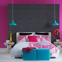 Tropical pink bedroom    Team a palette of super-charged brights with black for a chic tropical look.    The oversized pattern on the bed linen is the focus of attention in this bedroom. The 'look-at-me' design draws attention to the bed, while other patterns are kept relatively low key.
