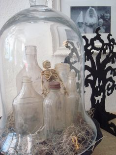 STARSHINE CHIC decorating on a dime or even less: Happy Halloween! old bottles and skeleton under dome cloche