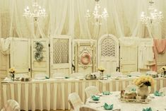 Gorgeous!  These old doors made a gorgeous wedding backdrop! Just can't get enough of these vintage doors.  doors and weddings.  vintage wedding.  shabby chic wedding. wedding decor ideas.  white wedding.vintage doors.  repurposed doors.