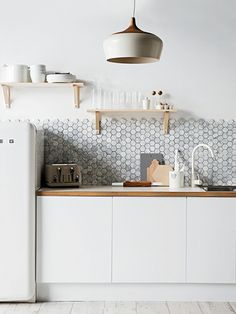 simple kitchen with honeycomb tiles