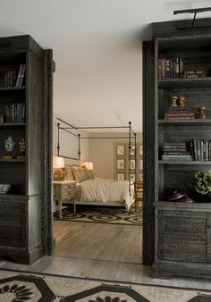 dividing a room with gorgeous bookshelves!  And look at the hardwood floor!