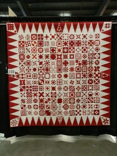 """""""Infinite Gratitude"""" by Deborah Semel Bingham, New York, New York.  """"This quilt was made in 2011 for Joanna Semel Rose in thanks for her exhibition, Infinite Variety: Three Centuries of Red and White Quilts.  Thirty six quilters worked together for nine months, in time for her 81st birthday.  We knew this was one quilt design she did not have in her vast collection!"""""""