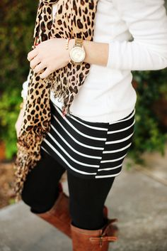 Are you a fan of mixing prints? Black leggings are the perfect canvas to try new things like mixing stripes with leopard print. What do you dare to wear with your leggings? fall fashions, leopard scarf, skirt outfits boots, mixed prints, mix print, mini skirts, brown boots, leopard prints, leopard print scarf outfit