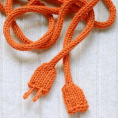 from KnitKnit: This is a fun knitted power cord! It can be worn as a decorative skinny scarf, o...
