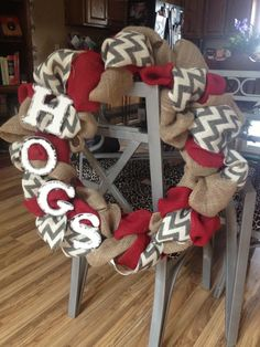 love the idea of mixing in colors and patterns on the burlap wreath