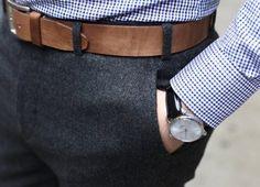 Dark grey trousers and brown belt