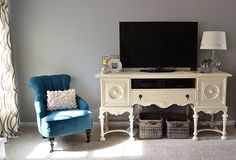 A vintage buffet turned media center against a Benjamin Moore Coventry Gray HC-169 backdrop.