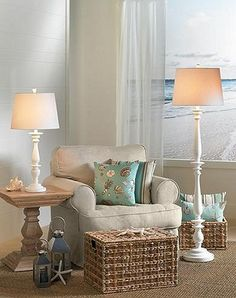 Antique whites, soft blues and aqua, light beige woods work together to create a harmonious coastal living room. Texture also plays an important role in creating a cohesive coastal look - the woven rattan baskets and coarse sisal jute area rug.  ~y~3