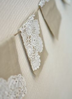 Linen and doilies - banner - can acheive a similar look with paper doilies if necessary @Amanda Snelson Norris this reminded me of you