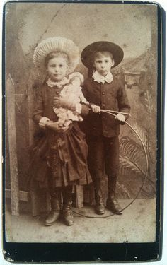 Boy with hoop and girl with doll cdv by smokey lace, via Flickr
