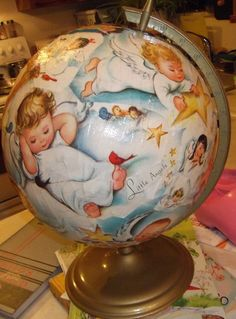 Decoupage an old globe with wrapping paper