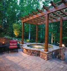 Pergola over built-in hot tub by Miller Landscape