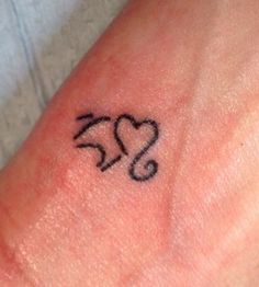 Small heart elephant tattoo