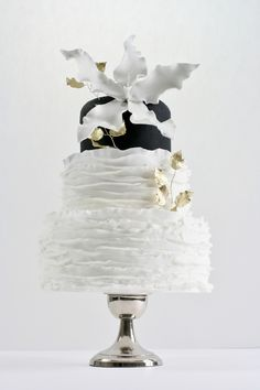White, black, and gold wedding cake