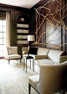 Love this tip explaining how to create afresh, light look in an interior with dark wood paneling. No painting involved.