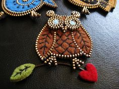 Brown felt and zipper owl brooch