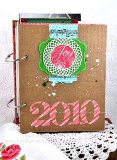 Christmas card mini-book.  Cute idea to save those photo cards, etc each year.