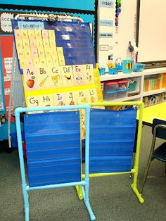 Make pocket chart stands by cutting PVC pipe and painting! :)
