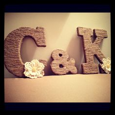 It's even our initials!! Twine Wrapped Rustic Wooden Letters with Crochet Lace Pearl Flower (25.00 per Letter). $25.00, via Etsy.