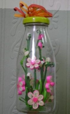 paper quilled flowers in bottle.